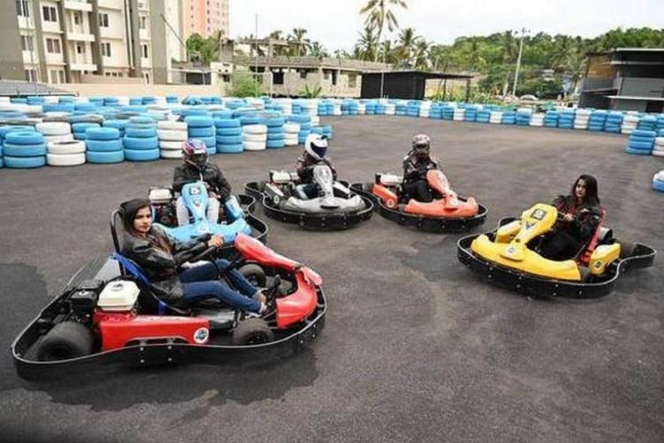 Five people on karts at the first go-karting circuit in Kerala, in Akkulam, Thiruvananthapuram