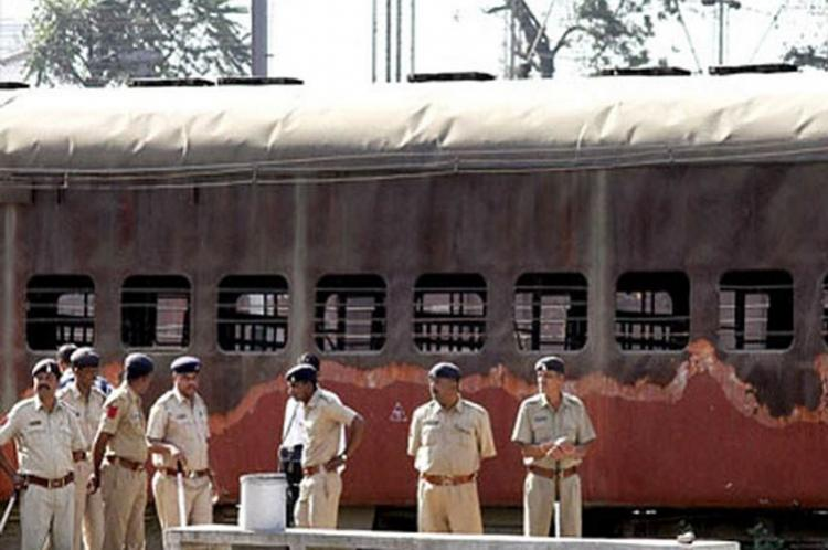 Godhra train attack Gujarat HC commutes death sentences of 11 convicts to life terms