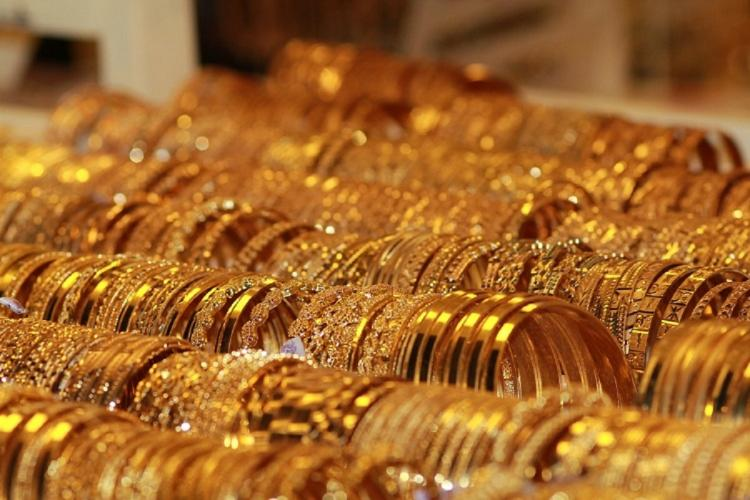 Rows of gold bangles placed in a store