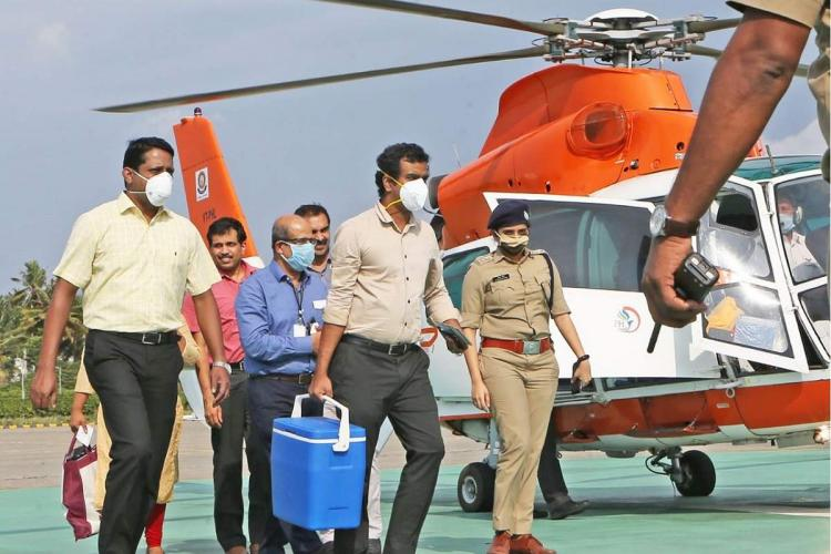 Doctors and police carry organ to helicopter