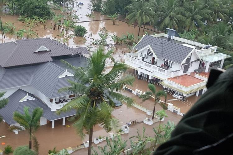 Kerala floods Additional helicopters boats called in to give push to rescue ops