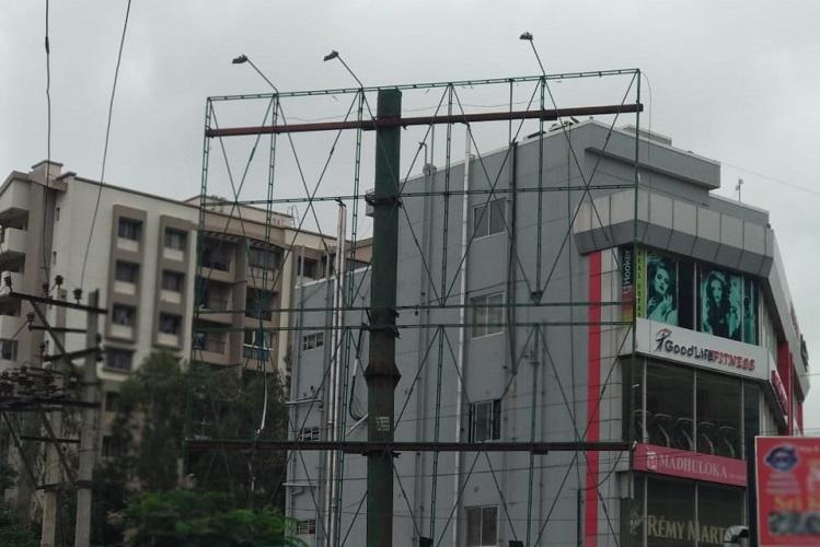 Hoarding for which 25 trees were culled in Bengaluru pulled down for the second time