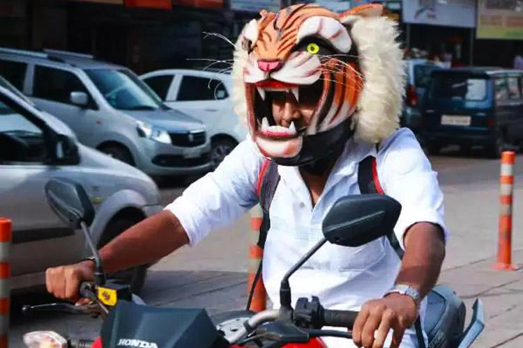 This Mangaluru mans Hulivesha helmet promotes local art form and road safety too