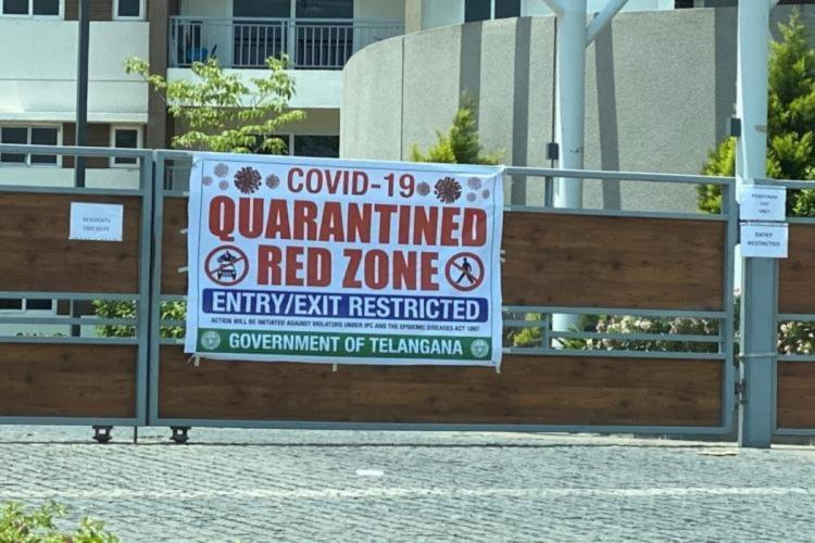 Banner outside gated community announcing containment zone in Telangana