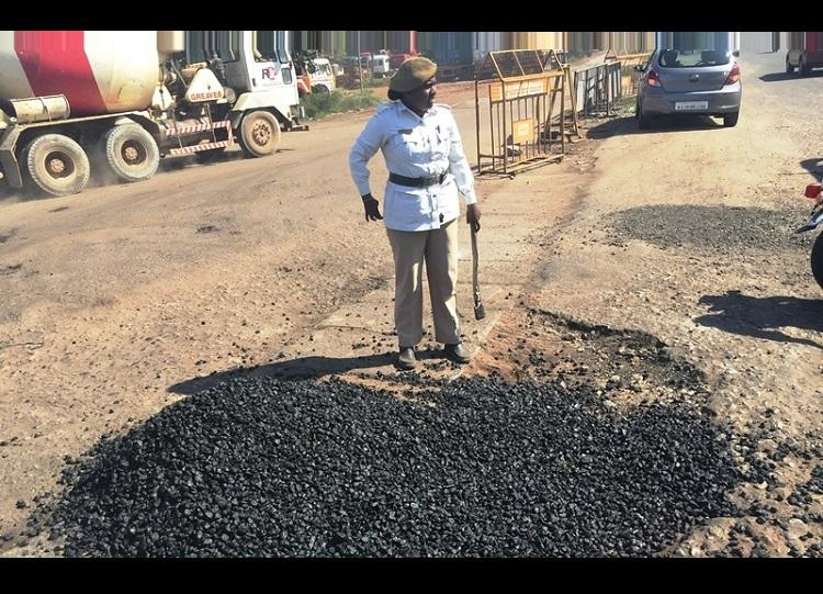 Fed up of potholes on NH 66 lady home guard fixes the road herself