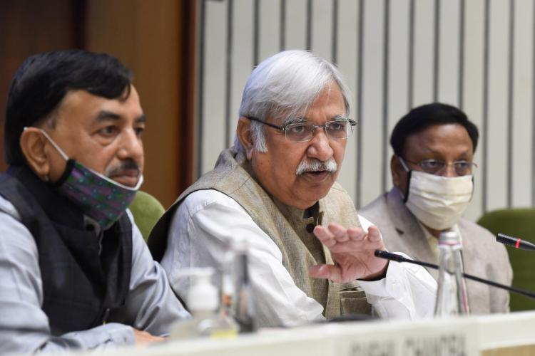 Chief Election Commissioner Sunil Arora with Election Commissioners Sushil Chandra on the left and Rajiv Kumar on the right announces the schedule for the Bihar Assembly Elections 2020 at a press conference in New Delhi Sunil Arora who is wearing a white shirt khaki Nehru jacket and no mask is holding the mike and speaking