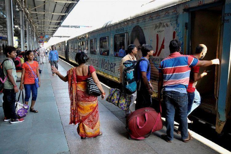 Passengers boarding on a train Indian Railways