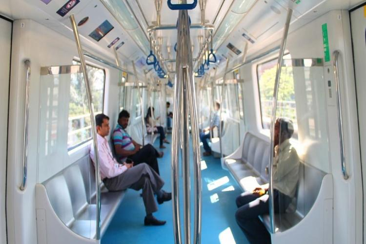 Passengers sitting inside a Bengaluru metro train