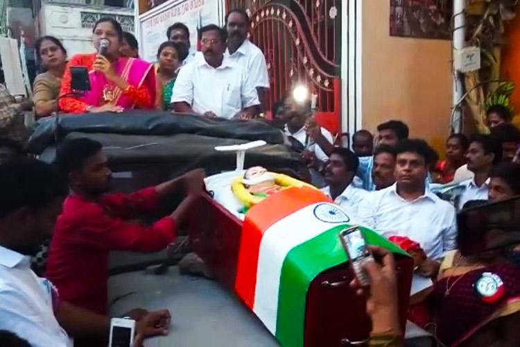 TN bypolls just got disgusting OPS camp parades fake Jaya body and coffin at campaign