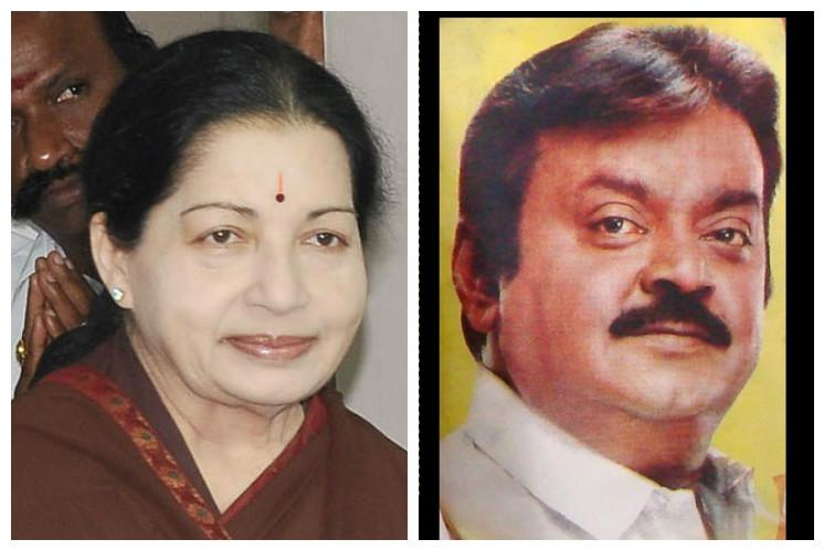 Video Supporters of Jayalalithaa and Vijayakanth tear down posters following clashes in Thanjavur