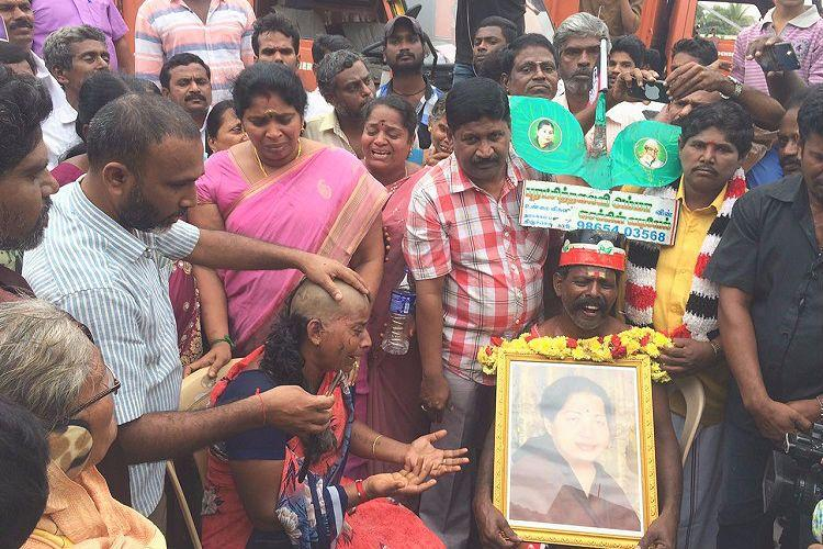 Amma has become God for us Grieving Jayalalithaa supporters tonsure heads at memorial site