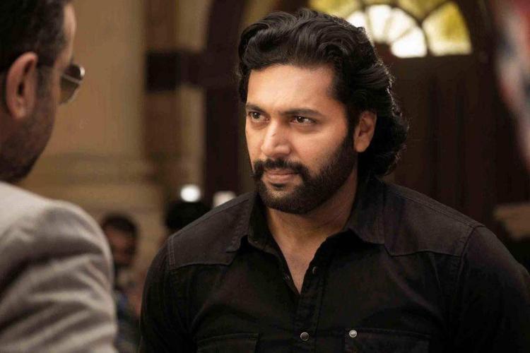 Jayam Ravi wearing black shirt