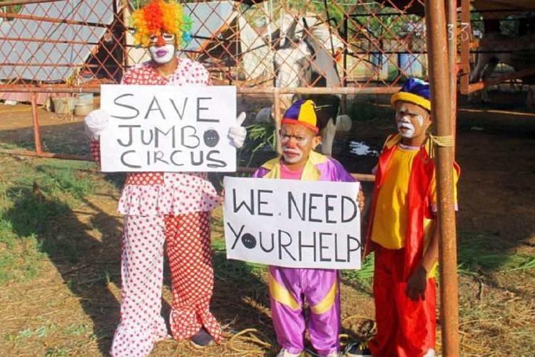 Circus clowns hold save Jumbo cards