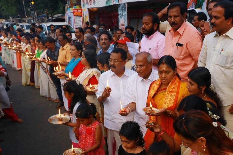 BJP says Ayyappa Jyothi event bigger than Womens Wall CPIM says wait for Jan 1