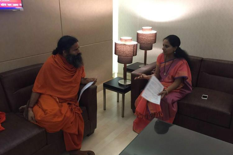 TRS MP Kavitha meets Ramdev seeks support for setting up turmeric board in India