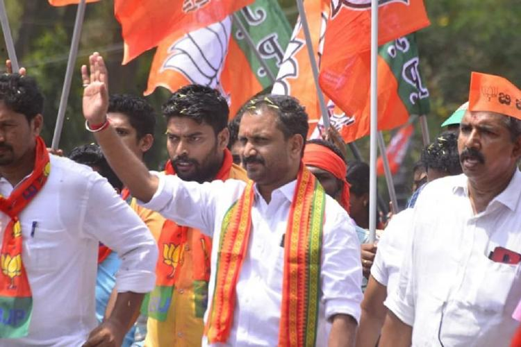 Kerala state BJP President K Surendran waving to supporters during campaigning