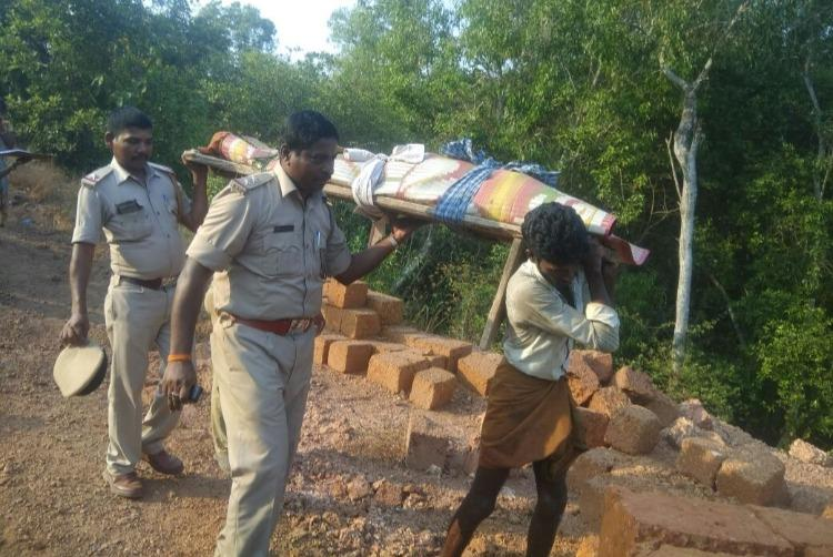 Karnataka cops carry dead body of 80-year-old down a hill after locals refuse