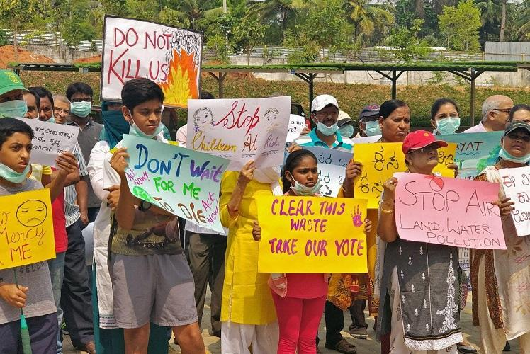 Irked by toxic fumes out of burning garbage Bengaluru residents hit the streets