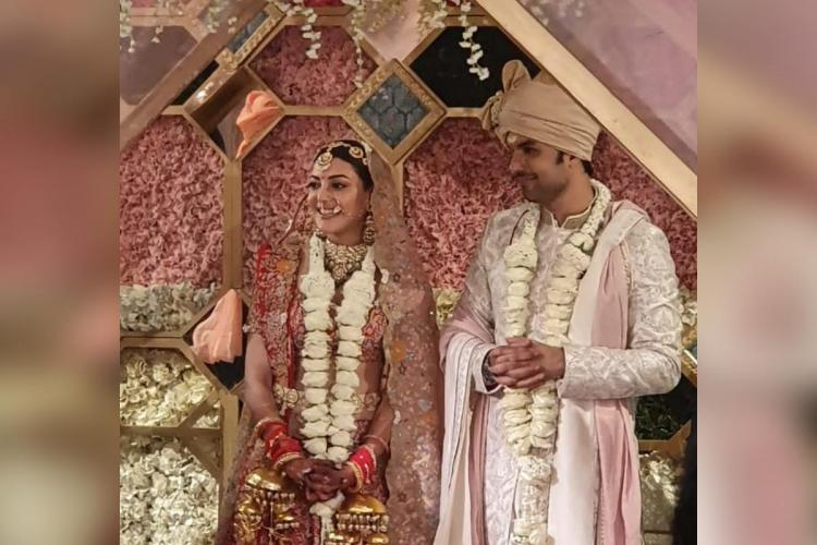 Kajal Aggarwal and husband Gautam Kitchlu in wedding clothes at the ceremony