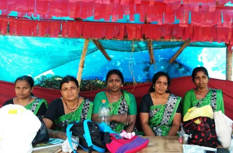 6 firebrand women protest Thrissur Kalyan Sarees unit closure management claims recession