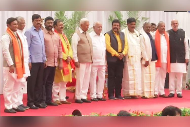 Karnataka cabinet expansion 10 turncoat MLAs take oath as ministers