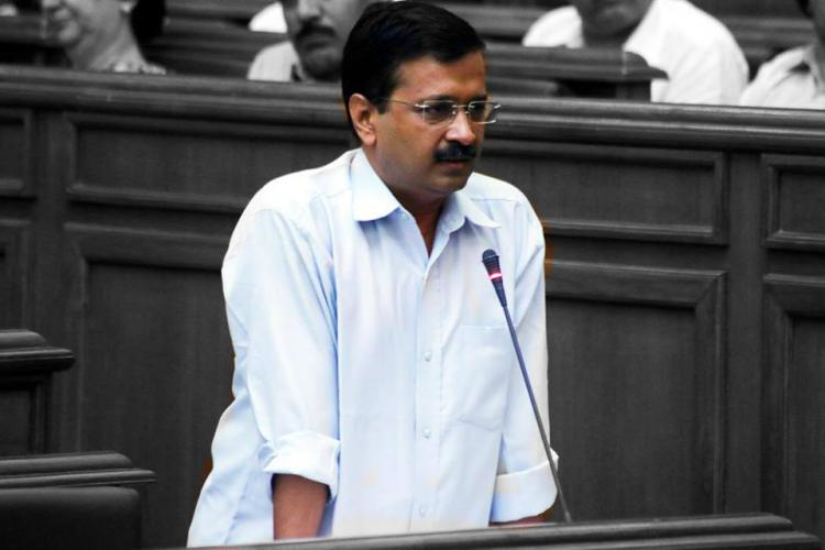 Woman throws ink on Kejriwal alleging CNG scam AAP points fingers at Delhi police