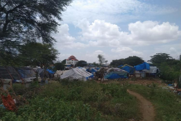 View of Karcharkanahalli slum with temple visible in the background