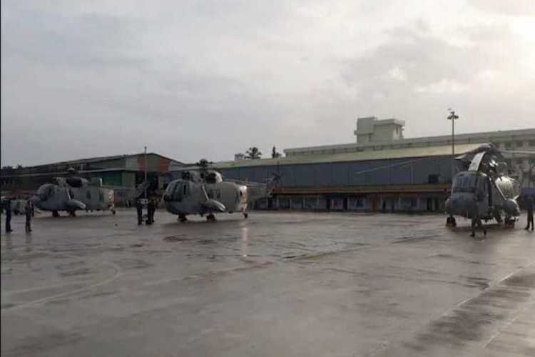 2 die after helicopter hangar door collapses at naval air station in Kochi