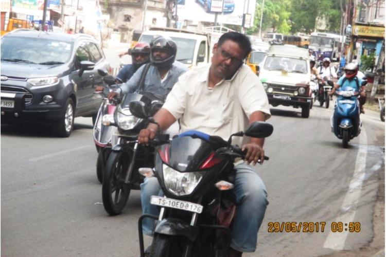 Telangana cops catch man for riding without helmet realise he faces 135 cases