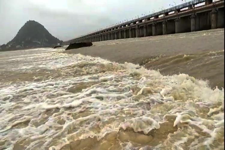 Krishna river water flowing near a dam in mud colour