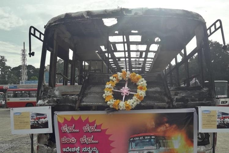 At Bengaluru bus stand a burnt bus asks commuters to refrain from vandalism