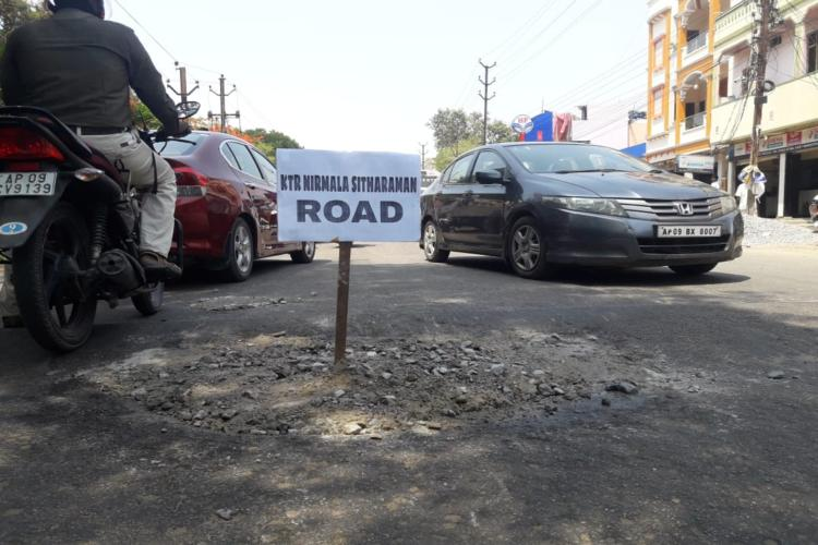 Gandhigiri protest Third road in Hyd repaired by residents and named after KTR