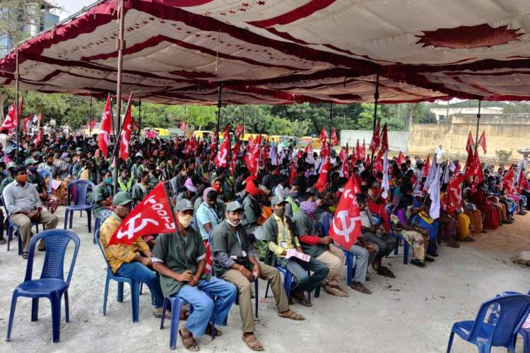 Scores gathered in Bengaluru protesting the change in security provisions for workers
