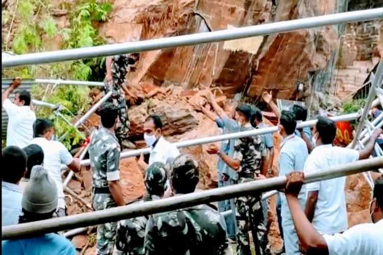 Police personnel clearing the scene as the debris fallen at Indrakeeladri of Vijayawada