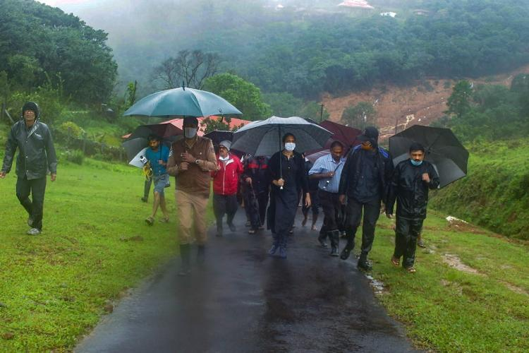 People walking with umbrellas in Kodagu