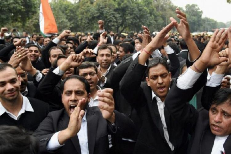 Patiala House Court scuffle Lawyer caught on camera thrashing journos students arrested