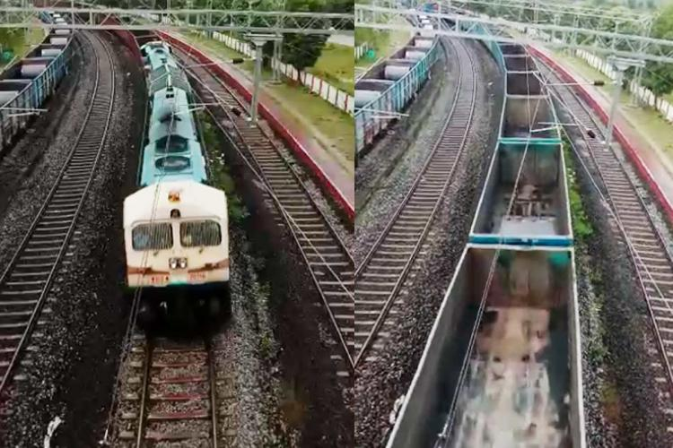 long laul train standing on railway track