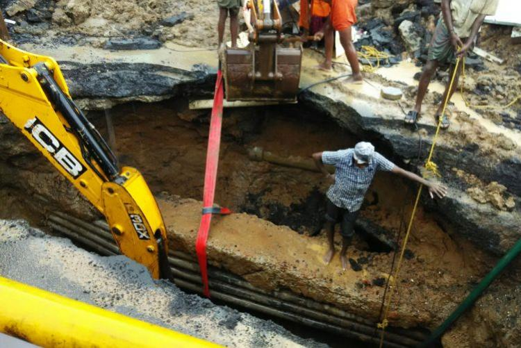 After road caves in Chennai city officials work to mend them