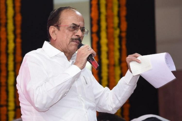 A file photo of Telangana Home Minister Mahmood Ali holding a mic in one hand and a piece of paper in the other, as he addresses a gathering