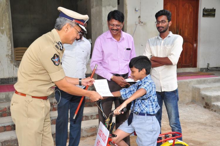 Meet Helmet Boy Vijayawadas tiny road safety warrior who is winning hearts