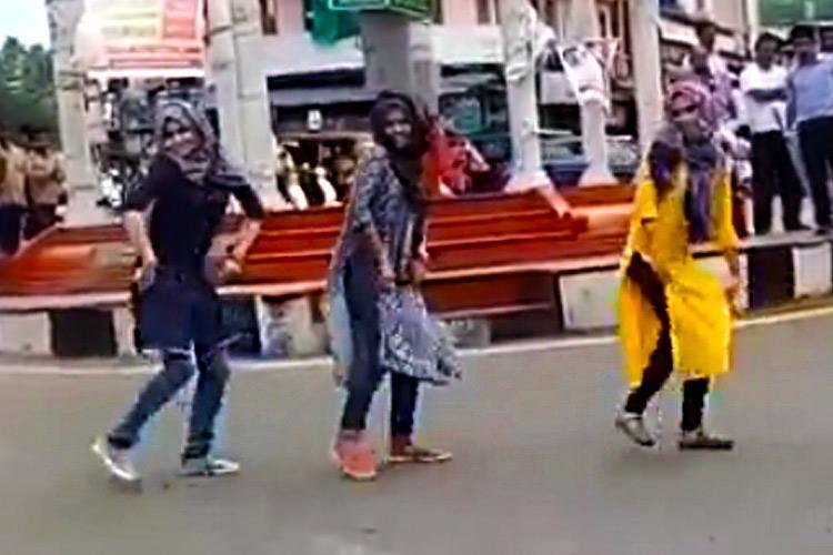 Kerala Muslim girls flash mob Womens Commission demands action against trolls