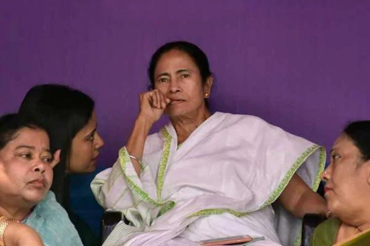 Mamata Banerjee ends dharna claims moral victory No arrest of Rajeev Kumar says SC