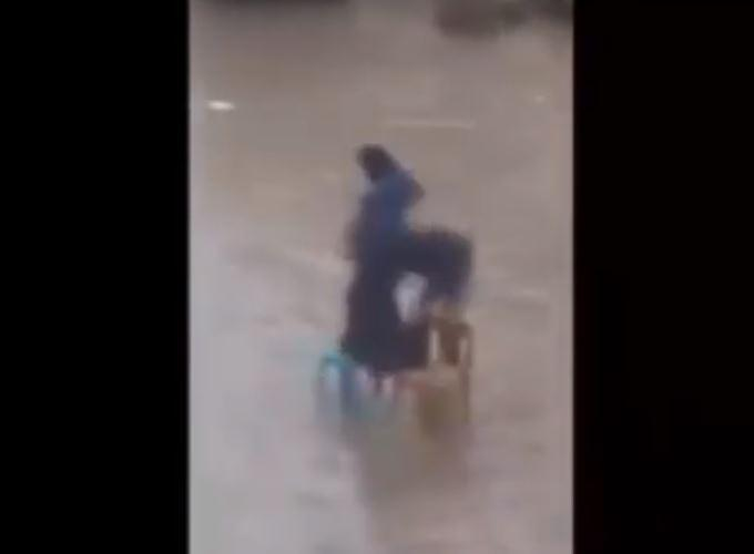 Viral video Watch Husband of the year help wife cross a flooded street