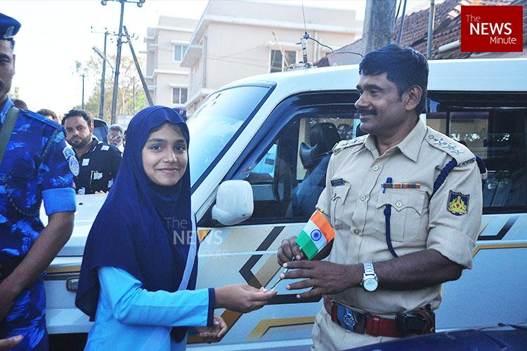 Protesters gift roses and national flags to police during anti-CAA protest in Mangaluru