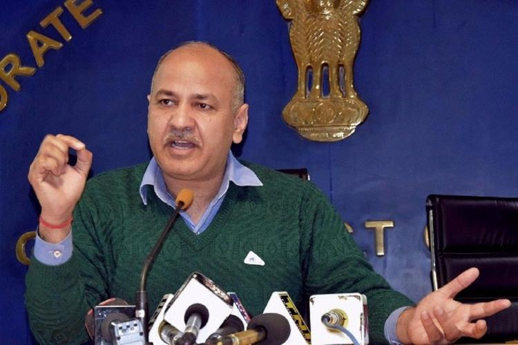Delhi Deputy Chief Minister Manish Sisodia addresses a press meet