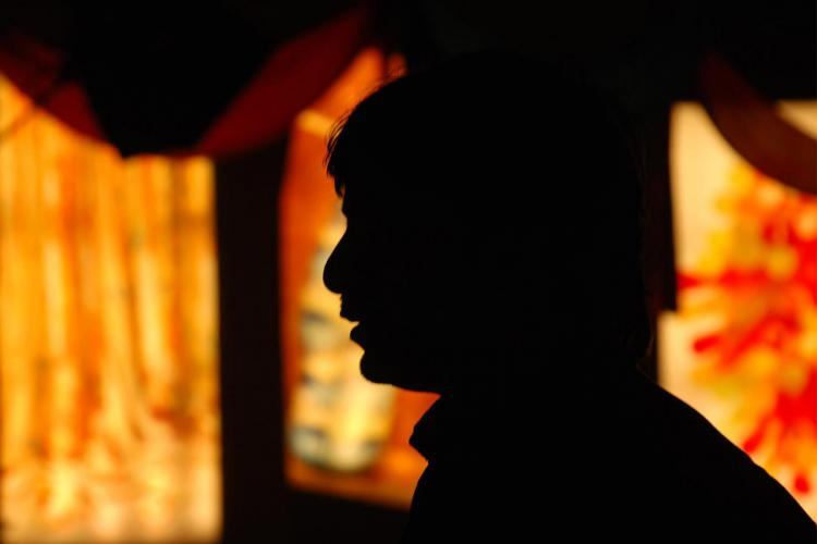 Man standing against light source silhouette