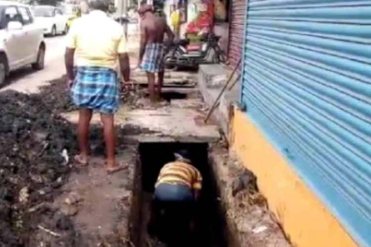 People working in the drains without protective gears