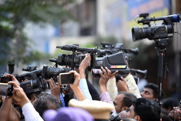 A file photo of a group of media persons holding up cameras