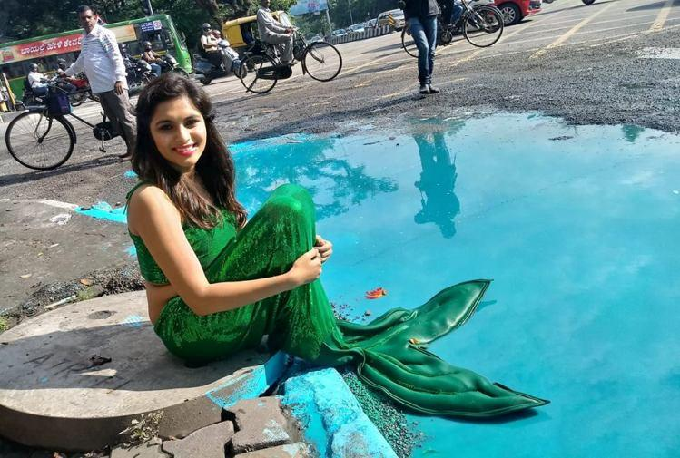 As Bengalurus potholed streets flood even the mermaids have come out to play