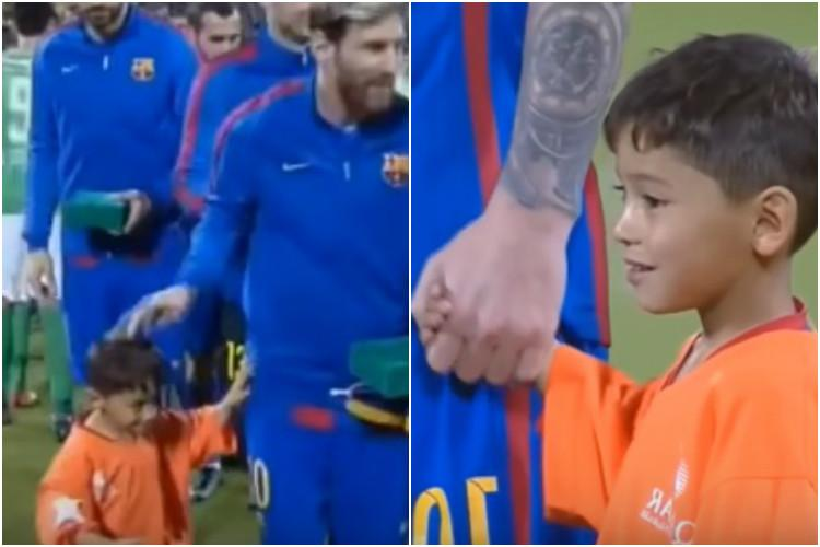 Watch Six-year-old Afghan boy meets Messi and just wouldnt let go of him